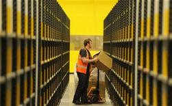 <p>A worker lifts a box at Amazon's new fulfilment centre after it was opened by Scotland's First Minister Alex Salmond in Dunfermline, Scotland, November 15, 2011.The warehouse covers more than one million square feet (93,000 square metres), about the size of 14 soccer pitches, and is Amazon?s biggest in the United Kingdom. It will create 750 permanent jobs, along with a further 1,500 temporary jobs during peak periods. REUTERS/Russell Cheyne (BRITAIN - Tags: POLITICS BUSINESS)</p>