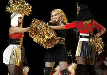 <p>Madonna performs during the halftime show with Nicki Minaj (L) and M.I.A. in the NFL Super Bowl XLVI football game in Indianapolis, Indiana, February 5, 2012. REUTERS/Mike Segar</p>