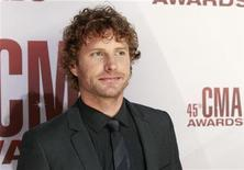 <p>Singer Dierks Bentley arrives at the 45th Country Music Association Awards in Nashville, Tennessee November 9, 2011. REUTERS/Harrison McClary</p>