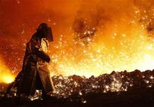 <p>A worker controls the cast at a blast furnace of German steel manufacturer Salzgitter AG in Salzgitter March 24, 2010. REUTERS/Christian Charisius/Files</p>