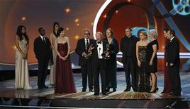 "<p>Writer Julian Fellowes accepts the award for outstanding miniseries or movie for ""Downton Abbey,"" at the 63rd Primetime Emmy Awards in Los Angeles September 18, 2011. REUTERS/Mario Anzuoni</p>"