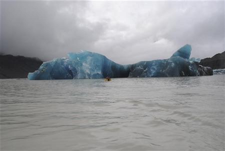 An iceberg, broken off from the glacier after Tuesday's earthquake, is seen in the Tasman Lake, 200km (124 miles) southeast of Christchurch in this handout photograph released February 23, 2011. REUTERS/Denis Callesen/Handout