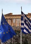<p>Les trois partis de la coalition gouvernementale en Grèce se sont mis d'accord sur un ensemble de nouvelles mesures d'austérité à mettre en oeuvre en échange d'un deuxième plan d'aide international à Athènes. /Photo prise le 8 février 2012/REUTERS/Yannis Behrakis</p>