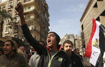 A protestor chants anti-military council slogans during a protest against the ruling military council near Tahrir square in Cairo February 8, 2012. REUTERS/Esam Al-Fetori