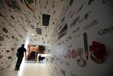 <p>A man walks through a tunnel of Google homepage logos at the Google campus near Venice Beach, in Los Angeles, California January 13, 2012. REUTERS/Lucy Nicholson</p>