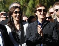 <p>British singer Paul McCartney applauds next to his wife Nancy Shevell before unveiling his star on the Walk of Fame in Hollywood, California February 9, 2012. REUTERS/Mario Anzuoni</p>