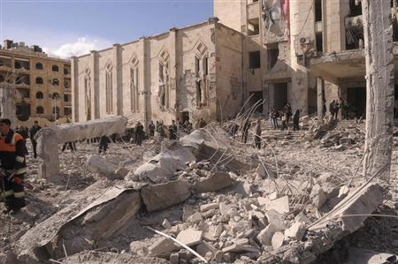 Syrian security and civil defence members inspect the site of an explosion in Syria's northern city of Aleppo February 10, 2012. REUTERS/George Orfalian