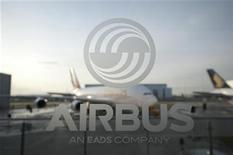 <p>An A380 aircraft is seen through a window with an Airbus logo during the EADS / Airbus 'New Year Press Conference' in Hamburg January 17, 2012. REUTERS/Morris Mac Matzen</p>