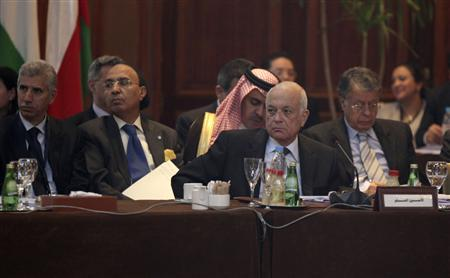Arab League Secretary General Nabil Elaraby (C) attends the Arab foreign ministers meeting in Cairo February 12, 2012. REUTERS/Mohammed Salem