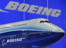 <p>A model of Boeing 747 passenger plane is displayed at the Asian Aerospace Expo in Hong Kong September 8, 2009. REUTERS/Bobby Yip</p>