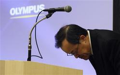 <p>Olympus Corp President Shuichi Takayama bows after speaking at a news conference in Tokyo February 13, 2012. Japan's scandal-hit Olympus Corp on Monday forecast a $410 million full-year net loss due to its ailing camera business and tax asset writedowns, but strength in its core endoscope business highlighted its attractiveness to potential investors. REUTERS/Yuriko Nakao</p>