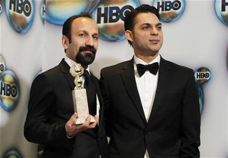 Director Asghar Farhadi (L) and actor Peyman Moadi pose with the award for best foreign film for ''A Separation'' as they arrive at the HBO after party after at the 69th annual Golden Globe Awards in Beverly Hills, California January 15, 2012. REUTERS/Danny Moloshok