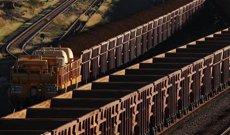 A train loaded with iron ore travels towards the Rio Tinto Parker Point iron ore facility in Dampier in the Pilbara region of Western Australia April 20, 2011. REUTERS/Daniel Munoz
