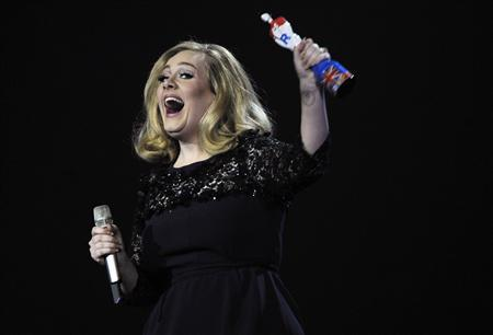 Adele reacts as she holds her award for best British album of the year during the BRIT Music Awards at the O2 Arena in London February 21, 2012. REUTERS/Dylan Martinez