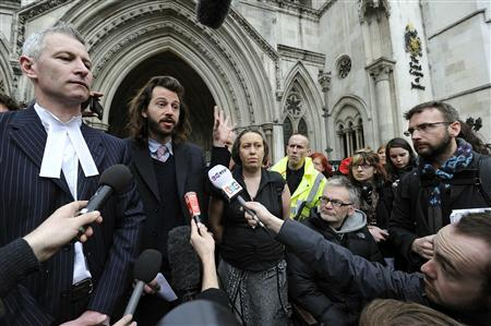 Occupy London lawyer, Michael Paget (L), and representatives George Barda (2nd L) and Tammy Samede (C) from the occupy St Paul's camp speak to members of the media outside the High Court in London February 22, 2012. REUTERS/Paul Hackett