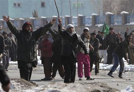Afghan men shout anti-U.S slogans during a protest in Kabul February 23, 2012. REUTERS/Omar Sobhani