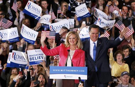 Mitt Romney waves to supporters along with his wife Ann at his ''Super Tuesday'' primary election night rally in Boston, Massachusetts, March 6, 2012. REUTERS/Jessica Rinaldi