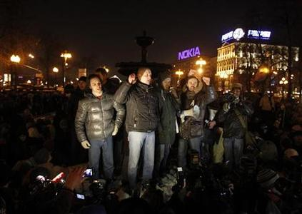 Opposition leader Sergei Udaltsov (C) speaks to supporters during a protest demanding fair elections in central Moscow March 5, 2012. REUTERS/Denis Sinyakov