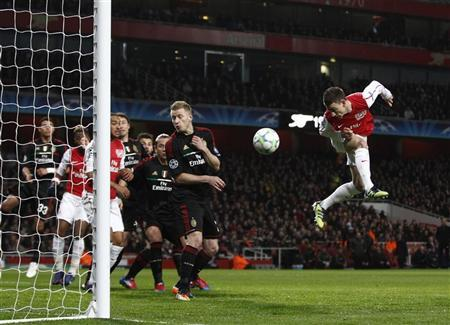 Arsenal's Laurent Koscielny scores a goal against AC Milan during their Champions League last 16 second leg soccer match at the Emirates Stadium in London March 6, 2012. REUTERS/Eddie Keogh