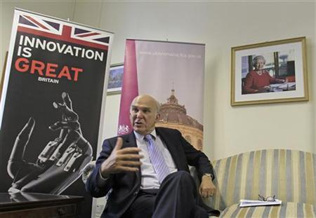 Business Secretary Vince Cable answers a question during an interview in Bucharest September 29, 2011. REUTERS/Radu Sigheti (ROMANIA - Tags: BUSINESS)