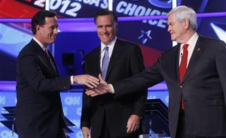 Republican presidential candidate former U.S. Senator Rick Santorum (R-PA) shakes hands with former House Speaker Newt Gingrich (R) as former Massachusetts Governor Mitt Romney looks on before the Republican presidential candidates debate in Charleston, South Carolina, January 19, 2012. REUTERS/Eric Thayer