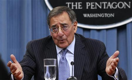 U.S. Defense Secretary Leon Panetta gestures as he briefs the media at the Pentagon Briefing Room in Washington, DC January 26, 2012. REUTERS/Kevin Lamarque