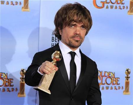 Peter Dinklage, winner of the award for best performance by an actor in a supporting role in a series, mini-series or motion picture made for television, for ''Game of Thrones,'' poses backstage at the 69th annual Golden Globe Awards in Beverly Hills, California, January 15, 2012. REUTERS/Lucy Nicholson