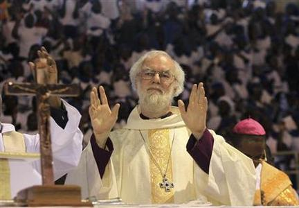 Head of Anglican Church, Archibishop of Canterbury Rowan Williams, greets people upon his arrival in a church service in the capital Harare, October 9, 2011. REUTERS-Philimon Bulawayo