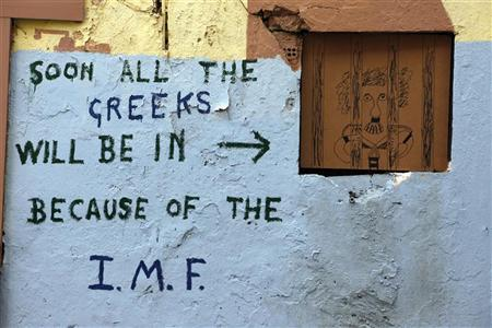 Graffiti is seen on the wall of a derelict building in the Plaka area of Athens March 13, 2012. REUTERS/Cathal McNaughton