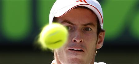 Andy Murray of Britain hits a backhand to Janko Tipsarevic of Serbia at the Sony Ericsson Open tennis tournament in Key Biscayne, Florida, March 28, 2012. REUTERS/Kevin Lamarque