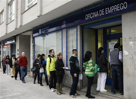 People enter a government employment office in Pontevedra, in the northwest of Spain April 3, 2012. REUTERS/Miguel Vidal