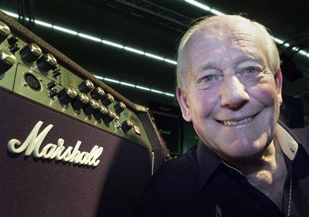 Jim Marshall, builder of amplifiers poses with one of his products at the 'Musikmesse' in Frankfurt March 13, 2002. REUTERS/Ralph Orlowski
