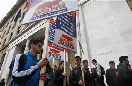Greek bondholders and members from communist-affiliated trade union PAME protest against their inclusion in a debt cut plan that saw the value of their bonds diminished, outside the Bank of Greece in Athens, April 5, 2012. REUTERS/John Kolesidis