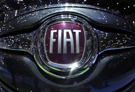 A logo is seen on a car displayed on the Fiat booth during the first media day of the Geneva Auto Show at the Palexpo in Geneva, March 6, 2012. REUTERS/Denis Balibouse
