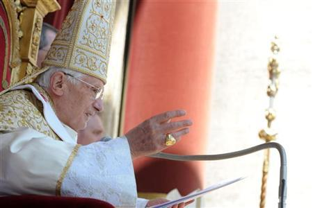 Pope Benedict XVI waves as he makes his ''Urbi et Orbi'' (To the city and the world) address from a balcony in St. Peter's Square in Vatican April 8, 2012. REUTERS/Osservatore Romano/Pool