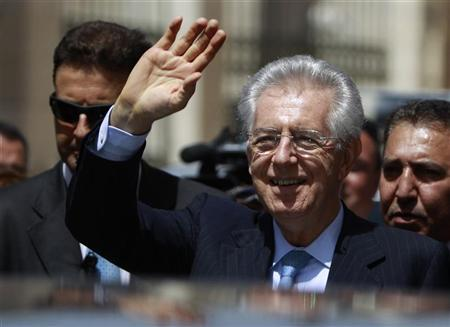 Italy's Prime Minister Mario Monti (C) waves as he leaves after visiting the Church of the Nativity, the site revered as the birthplace of Jesus, in the West Bank town of Bethlehem April 9, 2012. REUTERS/Ammar Awad