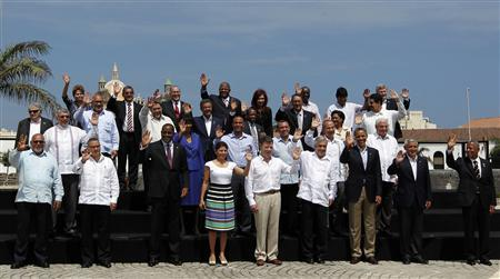 Brazil's President Dilma Rousseff, Belize's Deputy Prime Minister Gaspar Vega, Bahamas' Deputy Prime Minister Theodore Brent Symonette, Antigua and Barbuda's Prime Minister Winston Baldwin Spencer, Argentina's President Cristina Fernandez de Kirchner, Barbados' Prime Minister Freundel Stuart, Bolivia's President Evo Morales, Canada's Prime Minister Stephen Harper (back row, L-R), Uruguay's President Jose Mujica, Suriname's President Desi Bouterse, Saint Vincent and the Grenadines's Prime Minister Ralph Gonsalves, Dominican Republic's President Leonel Fernandez, Saint Kitts and Nevis' Prime Minister Denzil Douglas, Saint Lucia's Prime Minister Kenny Anthony, Trinidad and Tobago's Prime Minister Kamla Persad-Bissessar, Venezuela's Foreign Minister Nicolas Maduro, (2nd row from back, L-R) Paraguay's President Fernando Lugo, Jamaica's Prime Minister Portia Simpson Miller, Haiti's Foreign Minister Laurent Lamothe, Honduras' President Porfirio Lobo, Mexico's President Felipe Calderon, Panama's President Ricardo Martinelli, (2nd row from front, L-R) Guyana's President Donald Ramotar, El Salvador's President Mauricio Funes, Dominica's Prime Minister Roosevelt Skerrit, Costa Rica's President Laura Chinchilla, Colombia's President Juan Manuel Santos, Chile's President Sebastian Pinera, U.S. President Barack Obama, Guatemala's President Otto Perez and Grenada's Prime Minister Tillman Joseph Thomas (front row, L-R) pose for a group photo at the Americas Summit in Cartagena April 15, 2012. REUTERS/Enrique Marcarian