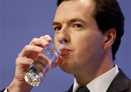 Britain's Chancellor George Osbourne drinks water during his speech to the Conservative Party annual conference, in Birmingham, central England. REUTERS/Stephen Hird (BRITAIN)