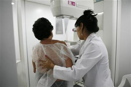 A woman undergoes a free mammogram inside Peru's first mobile unit for breast cancer detection, in Lima March 8, 2012. International Women's Day falls on March 8. REUTERS/Enrique Castro-Mendivil