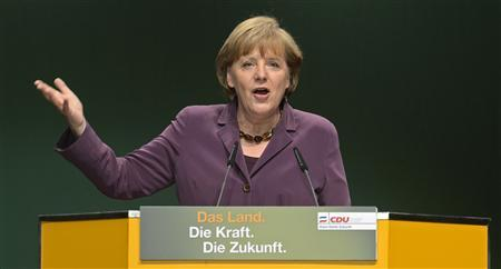 German Chancellor Angela Merkel delivers her speech during an election rally with Schleswig-Holstein's Christian Democratic (CDU) chairman and top candidate Jost de Jager (not pictured) in Kiel, April 18, 2012. REUTERS/Fabian Bimmer