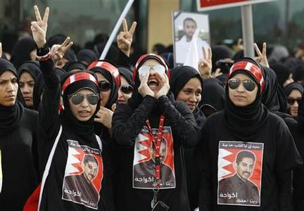 Protesters, wearing t-shirts with an image of Bahraini human rights activist Abdulhadi Al-Khawaja, shout anti-government slogans as they protest during a rally by Bahrain's main opposition party Al Wefaq in Budaiya, west of Manama, April 20, 2012. Pro-democracy protesters clashed with police in Bahrain's capital Manama on Friday as the Grand Prix event, a showcase for the Gulf state, got underway. REUTERS/Hamad I Mohammed