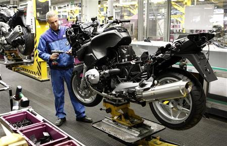 A BMW employee assembles a BMW motorcycle at the company's factory in Berlin, May 6, 2011. REUTERS/Fabrizio Bensch