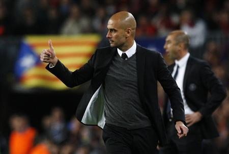 Barcelona's coach Pep Guardiola gestures during their Champions League semi-final second leg match against Chelsea at Camp Nou stadium in Barcelona, April 24, 2012. REUTERS/Albert Gea