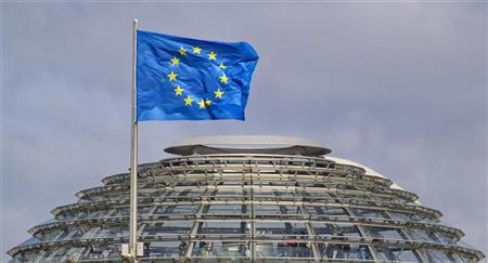 A European Union flag flies above the cupola of the Reichstag building, the seat of the Bundestag, the German lower house of parliament, as tourists visit the dome of the building, in Berlin April 2, 2012. REUTERS/Thomas Peter