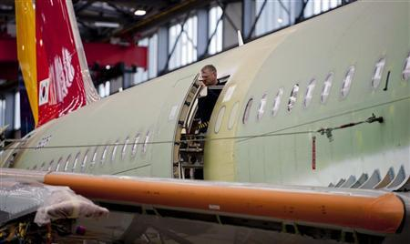 Airbus employees work on the door mechanism in a Single Aisle A320 production line at the Airbus facility in Finkenwerder near Hamburg January 17, 2012. REUTERS/Morris Mac Matzen