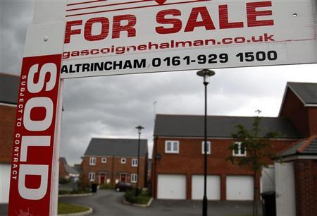 A sold sign hangs from a for sale board on a housing development in Manchester, northern England. REUTERS/Phil Noble