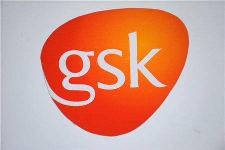 A GlaxoSmithKline logo is seen outside one of its buildings in west London, February 6, 2008. REUTERS/Toby Melville (BRITAIN)