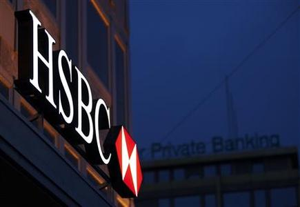 A HSBC logo is seen on the Private Bank Building in Geneva in this March 28, 2011 file photo. REUTERS/Denis Balibouse/Files