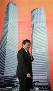Walter Kwok, Chairman & Chief Executive of Sun Hung Kai Properties, walks past a poster at the Shanghai IFC-HSBC Building Groundbreaking Ceremony in Pudong financial district, Shanghai, June 25, 2007. REUTERS/Aly Song
