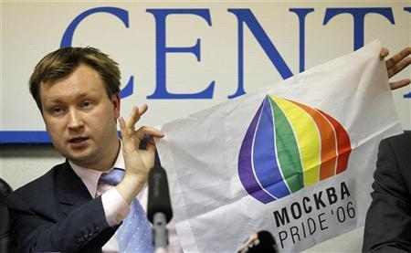 Nikolai Alexeyev, the head of a Russian gay rights group and main organizer of gay parades in Moscow, holds a flag, which reads: ''Moscow Pride '06'', during a news conference in Moscow, October 21, 2010. REUTERS/Tatyana Makeyeva